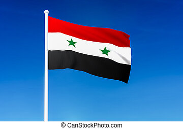 Waving flag of Syria on the blue sky background