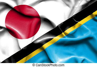 Waving flag of Tanzania and Japan