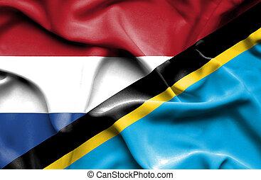 Waving flag of Tanzania and Netherlands