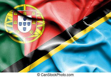 Waving flag of Tanzania and Portugal