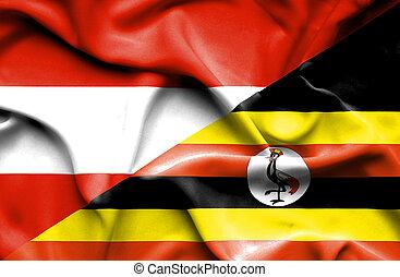 Waving flag of Uganda and Austria