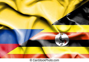 Waving flag of Uganda and Columbia