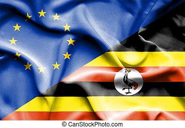 Waving flag of Uganda and EU