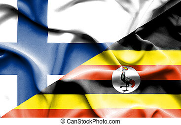 Waving flag of Uganda and Finland