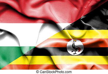 Waving flag of Uganda and Hungary