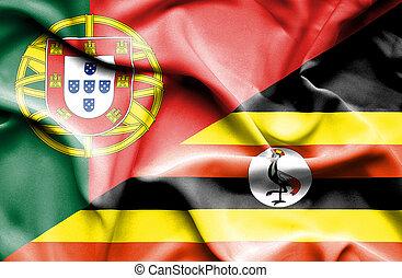 Waving flag of Uganda and Portugal