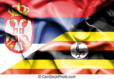 Waving flag of Uganda and Serbia