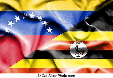 Waving flag of Uganda and Venezuela