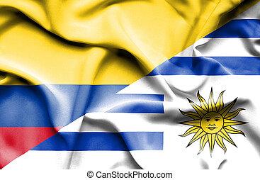 Waving flag of Uruguay and Columbia
