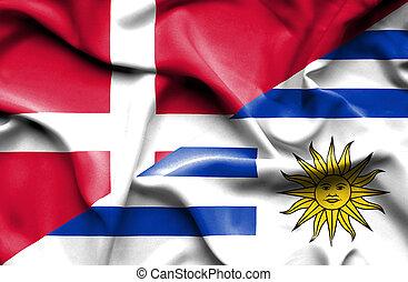 Waving flag of Uruguay and Denmark