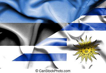 Waving flag of Uruguay and Estonia