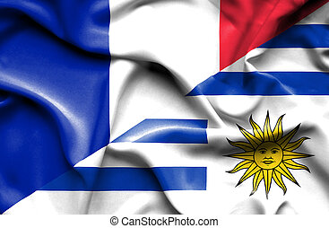 Waving flag of Uruguay and France