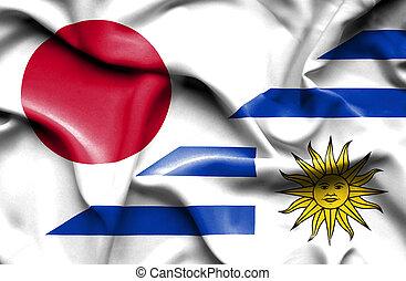 Waving flag of Uruguay and Japan