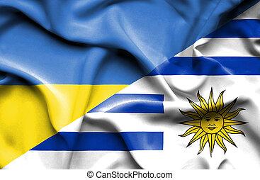 Waving flag of Uruguay and Ukraine