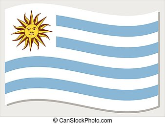 Waving flag of Uruguay vector graphic. Waving Uruguayan flag illustration. Uruguay country flag wavin in the wind is a symbol of freedom and independence.