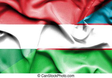 Waving flag of Uzbekistan and Hungary