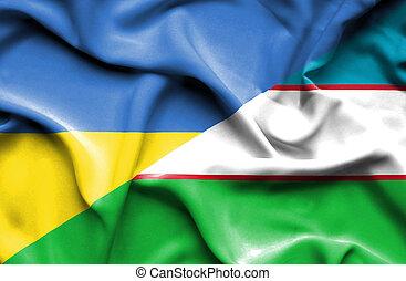 Waving flag of Uzbekistan and Ukraine