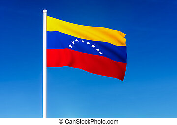 Waving flag of Venezuela on the blue sky background