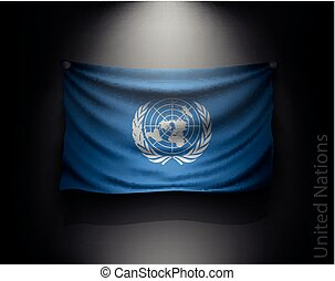 waving flag United Nations on a dark wall with a spotlight,...