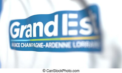 Waving flag with logo of Grand Est, a region of France....