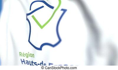 Waving flag with logo of Hauts-de-France, a region of...