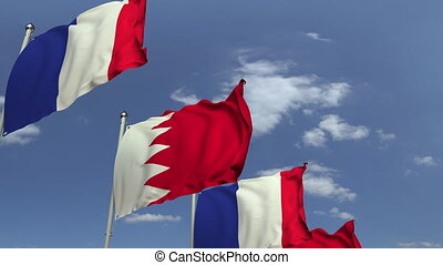 Waving flags of Bahrain and France, loopable 3D animation -...
