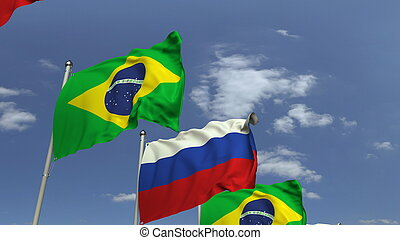 Waving flags of Brazil and Russia on sky background, 3D rendering