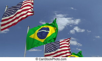 Waving flags of Brazil and the USA on sky background,...
