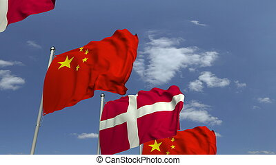 Waving flags of Denmark and China on sky background, 3D rendering