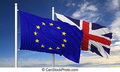 Waving flags of EU and UK on flagpole, on blue sky...