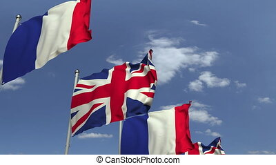 Waving flags of Great Britain and France on sky background, loopable 3D animation