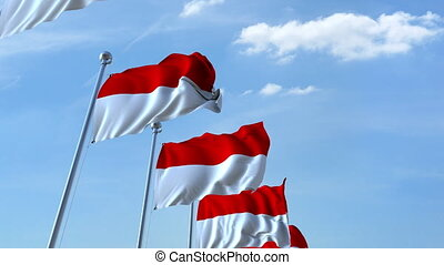 Waving flags of Indonesia against the sky, loopable 3D...