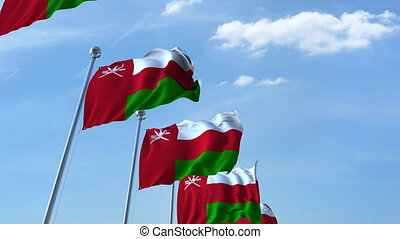 Waving flags of Oman against the sky, loopable 3D animation...