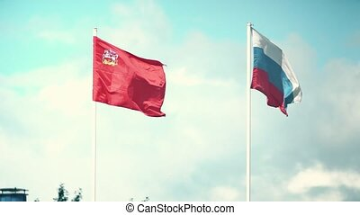 Waving flags of Russia and the Moscow Region. Slow motion...