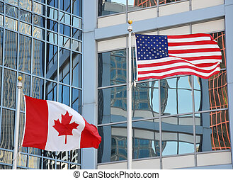Waving flags of USA and Canada