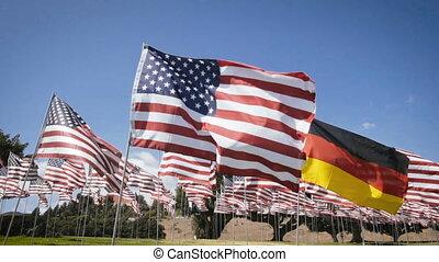 waving german flag in between american flags. diplomatic...