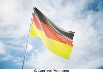 Waving German flag on a sky background