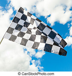 Waving in the wind checkered flag with blue sky and clouds on background - 1 to 1 ratio