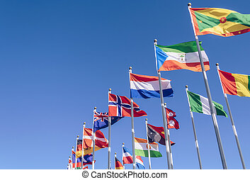 waving in the wind flags of different countries