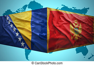 Waving Montenegrin and Bosnian flags of the political map of...