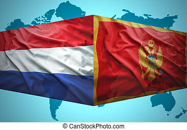 Waving Montenegrin and Dutch flags of the political map of...