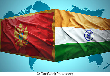 Waving Montenegrin and Indian flags of the political map of...