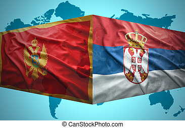 Waving Montenegrin and Serbian flags of the political map of...