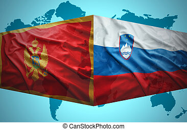 Waving Montenegrin and Slovenian flags of the political map...