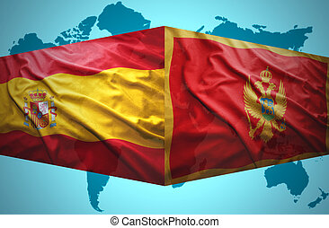 Waving Montenegrin and Spanish flags of the political map of...