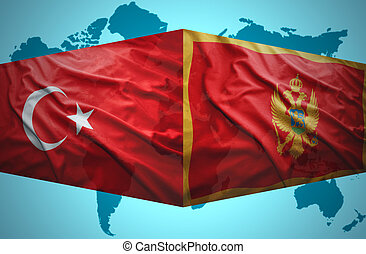 Waving Montenegrin and Turkish flags of the political map of...