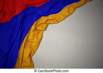 waving national flag of armenia on a gray background.