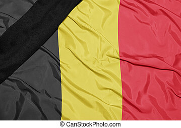 national flag of belgium with black mourning ribbon - waving...