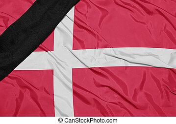 national flag of denmark with black mourning ribbon