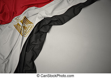 waving national flag of egypt on a gray background.